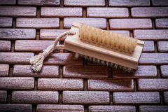 Wood scrubbing brush on textured table wooden mat top view healt Royalty Free Stock Photography