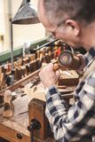 Wood sculptor working with mallet and chisel stock photography