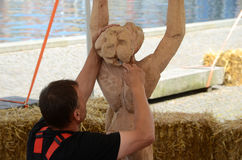 Wood Sculpture artist. Sonderborg, Denmark - June 22, 2017: International Wood Sculpture Festival 2017, Artists work on theur sculptures with chisels and Stock Photo