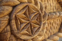 Wood sculpture. Old wood sculpture in natural light. An oak wooden pillar is carved with motifs  inspired from nature and then will be mounted on a maramures Stock Photo