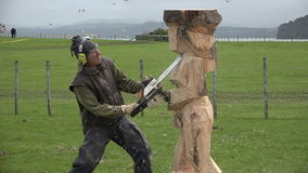 Wood sculpture sculpting a statue with a chainsaw. stock footage