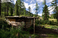 Wood shack (winter hut) in wild forest, Mountains Stock Photos
