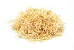 Wood shavings. A small pile of wood shavings on a white background stock image