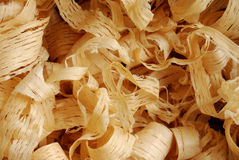 Wood shavings. Background with a close-up of thin wood shavings royalty free stock images
