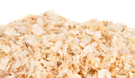 Wood shavings. Background of the golden curls of wood shavings royalty free stock images