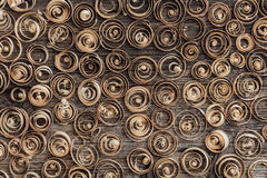 Wood shavings background. Wood spiral shavings on a vintage workbench background: carpentry, woodworking and craftsmanship concept royalty free stock photo