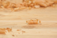 Wood shavings. Cedar wood shavings on unfinished table Stock Image