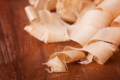 Wood shavings. Fine wood shavings over a wood board stock photos
