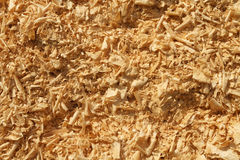 Wood Shavings And Sawdust Pile Background Texture. A close up shot of a pile of wood shavings and sawdust originally from a carpenters planer machine outside in Stock Photos