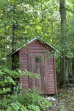 The Wood Shed. Faded red wood shed in the woods royalty free stock photos