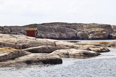 Wood shed on the rocks Royalty Free Stock Photos