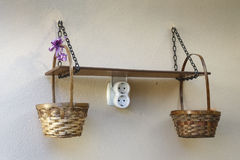 Wood shelf and baskets Royalty Free Stock Images