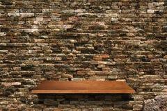 Wood shelf on brick wall background. Empty wood shelf on brick wall background for design work Royalty Free Stock Photo