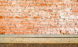 wood shelf and brick wall background royalty free stock photography