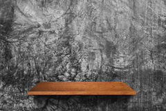 Wood shelf on cement wall background. Empty wood shelf on cement wall background for design work Stock Photography