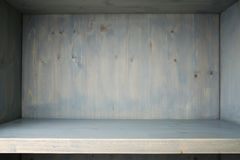 Empty blue painted wooden shelf. Wood shelf cupboard with grunge aging surface as background stock images