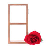 Wood shelf decorated with red rose flowers. On white background royalty free stock photo