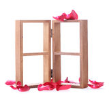 Wood shelf decorated with red rose flowers Royalty Free Stock Image