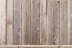 Wood shelf in front of wooden wall. View with copy space royalty free stock image