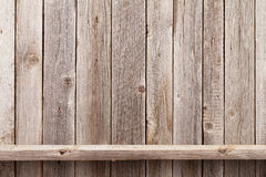 Wood shelf in front of wooden wall Royalty Free Stock Image