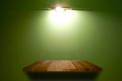 Wood  shelf on green wall. Stock Photo