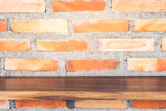 Wood shelf on red brick wall texture for background. royalty free stock image