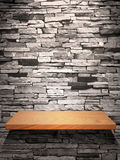 Wood shelf on stone wall Stock Images