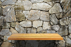 Wood shelf on stone wall Stock Photography