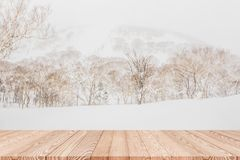 Wood shelf table with blurred background of mountain and trees stock photo