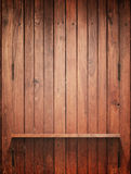 Wood Shelf on wall with light royalty free stock photography