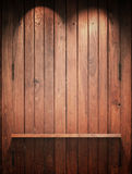 Wood Shelf on wall with Top light Stock Photo