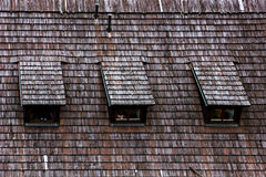 Wood shingle roof texture. Stock Photos