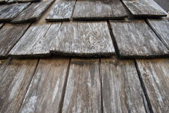 Wood shingle roof. Weathered, wooden roofing shingle tiles in situ. Closeup/detail Royalty Free Stock Photo