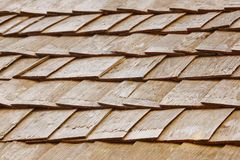 Wood shingle tiles on a roof. Finland traditional construction. Horizontal Royalty Free Stock Photography