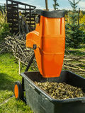 Wood shredder with wood chips Royalty Free Stock Image