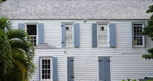 Wood Siding Building with Grey Shutters Stock Photography
