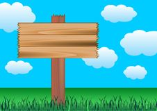 Wood sign. Informative sign with copy space over a cloudy blue sky Royalty Free Stock Photos