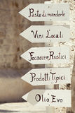 Wood Sign arrowhead with typical products of Italy's southern Puglia Italian Stock Photography