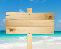 Wood sign in the beach. Stock Photo