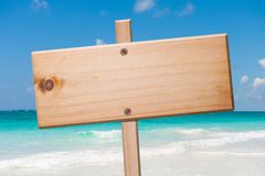Wood sign in the beach. Royalty Free Stock Image