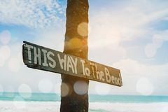 Wood sign board say This way to the beach. royalty free stock images