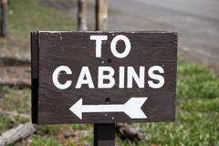 Wood sign for cabins. Rural travel sign for cabins stock photos