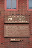 Wood sign directing people to Pot Holes,Shelburne Falls,Mass,2014. Rough hewn wood sign directing sightseers to ancient glacier pot holes, a geological wonder Royalty Free Stock Photos