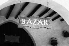 Wood painted sign at the entrance of an arab market. royalty free stock photo