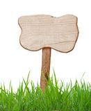 Wood sign. With field grass Royalty Free Stock Photos