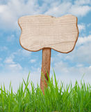 Wood sign. With field grass and blue sky Royalty Free Stock Photos