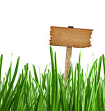 Wood sign with grass isolated on a white background Royalty Free Stock Image