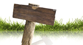 Wood sign and grass with reflection isolated Royalty Free Stock Images