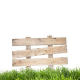 Wood sign with grass on white background. Royalty Free Stock Images