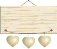 Wood sign with hanging hearts Royalty Free Stock Photography